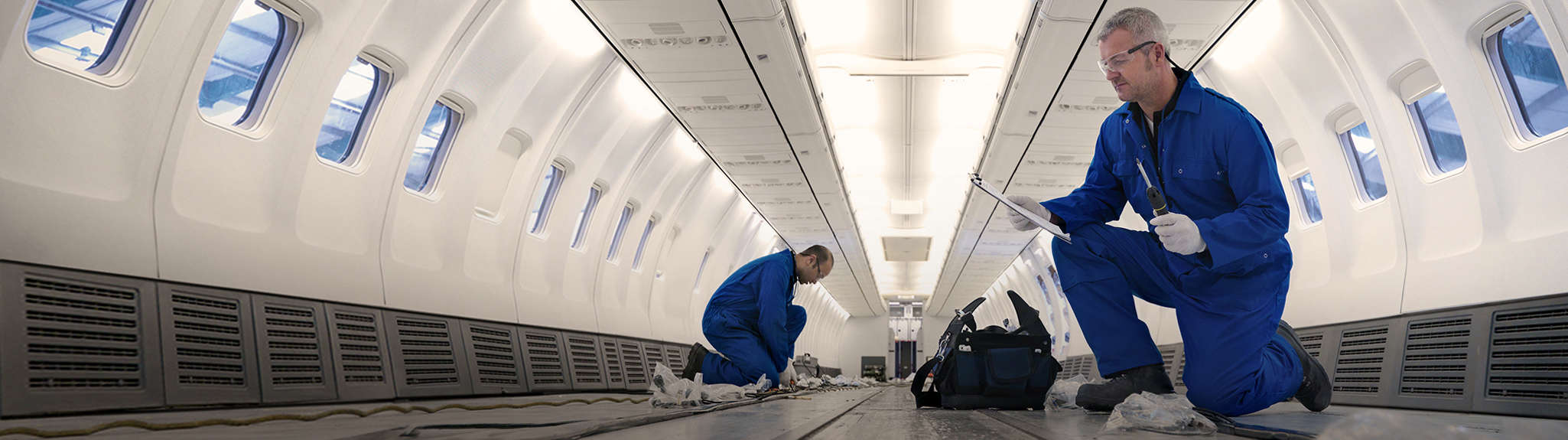 Roush aerospace, engineers inspecting interior of aircraft