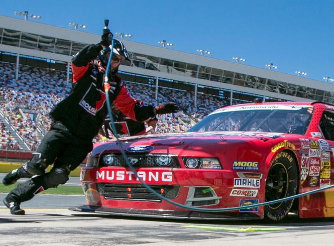 Roush Fenway Racing, red Mustang with tire changer